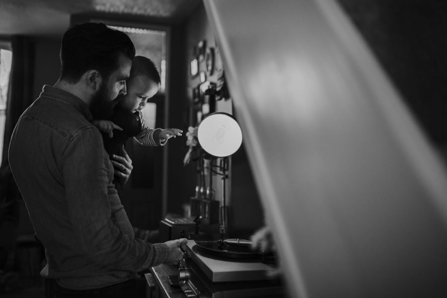 Dad playing a vinyl to his son during a documentary family photoshoot in Manchester UK