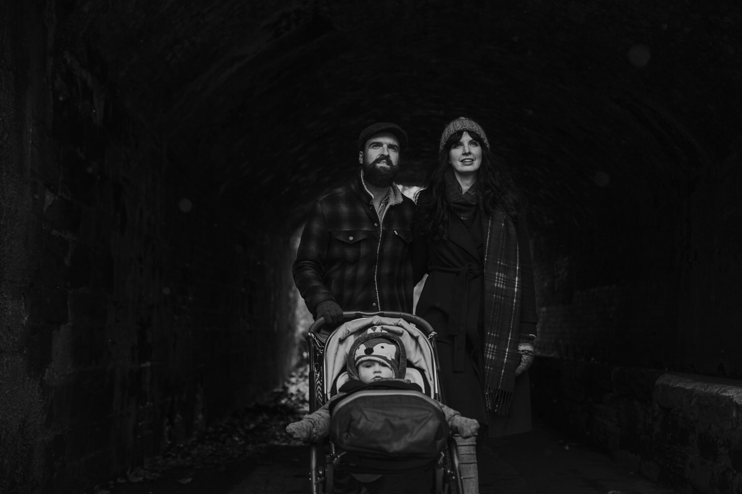 Clair obscur photo of parents with their baby