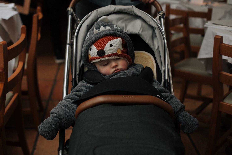 Baby asleep in his trolley