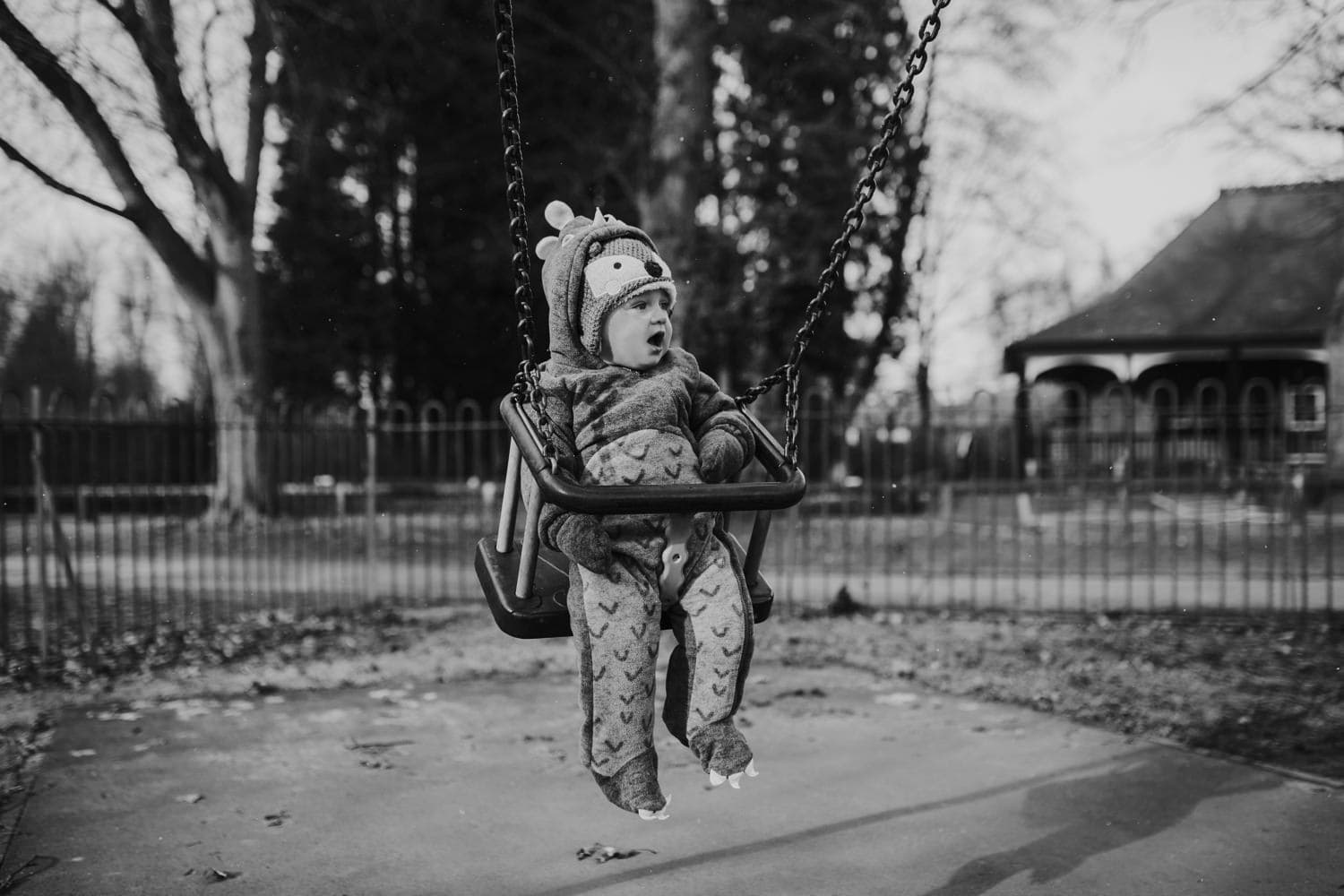 Toddler on the swing in Longford Park during a lifestyle family shoot in Manchester