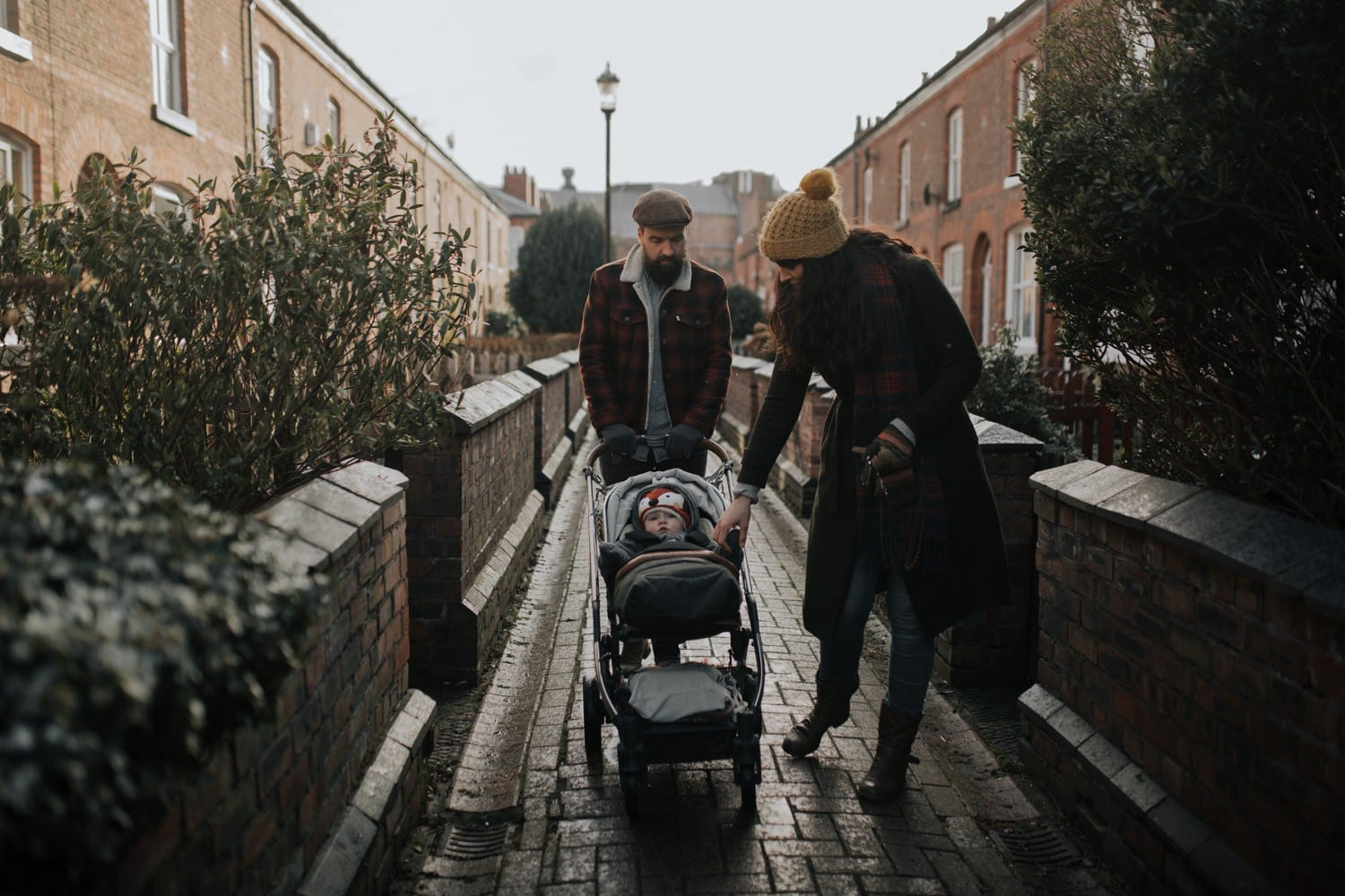 Parents in the alleyway in Stretford taken by a lifestyle family photographer
