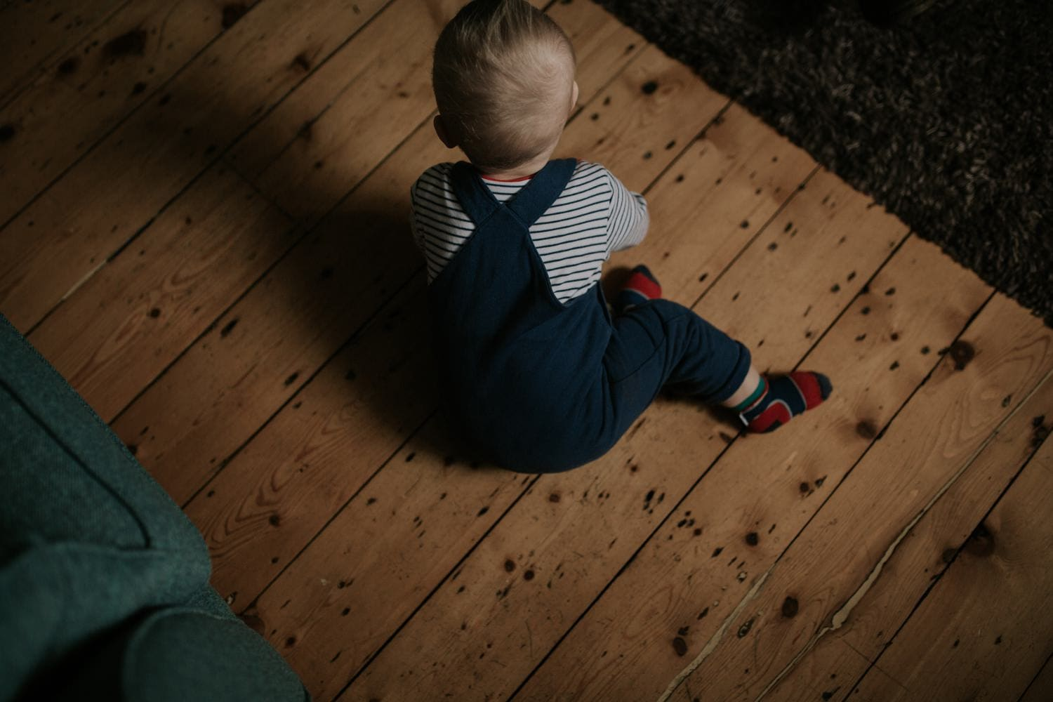 Baby on a stunning wooden floor in his house in Stretford