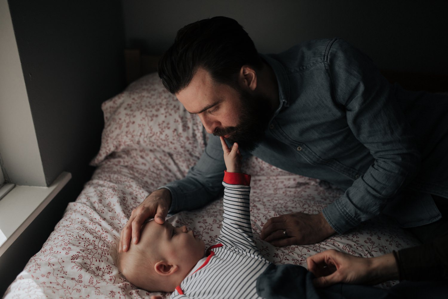 Baby touching his dad's beard in Manchester