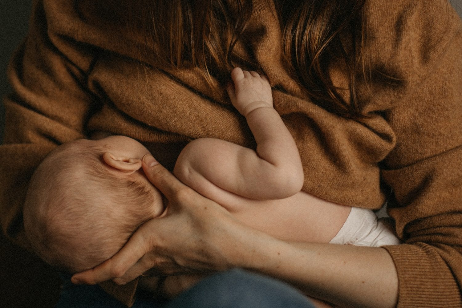 Close up of a breatfeeding mom and her baby during a newborn session in Islington London.